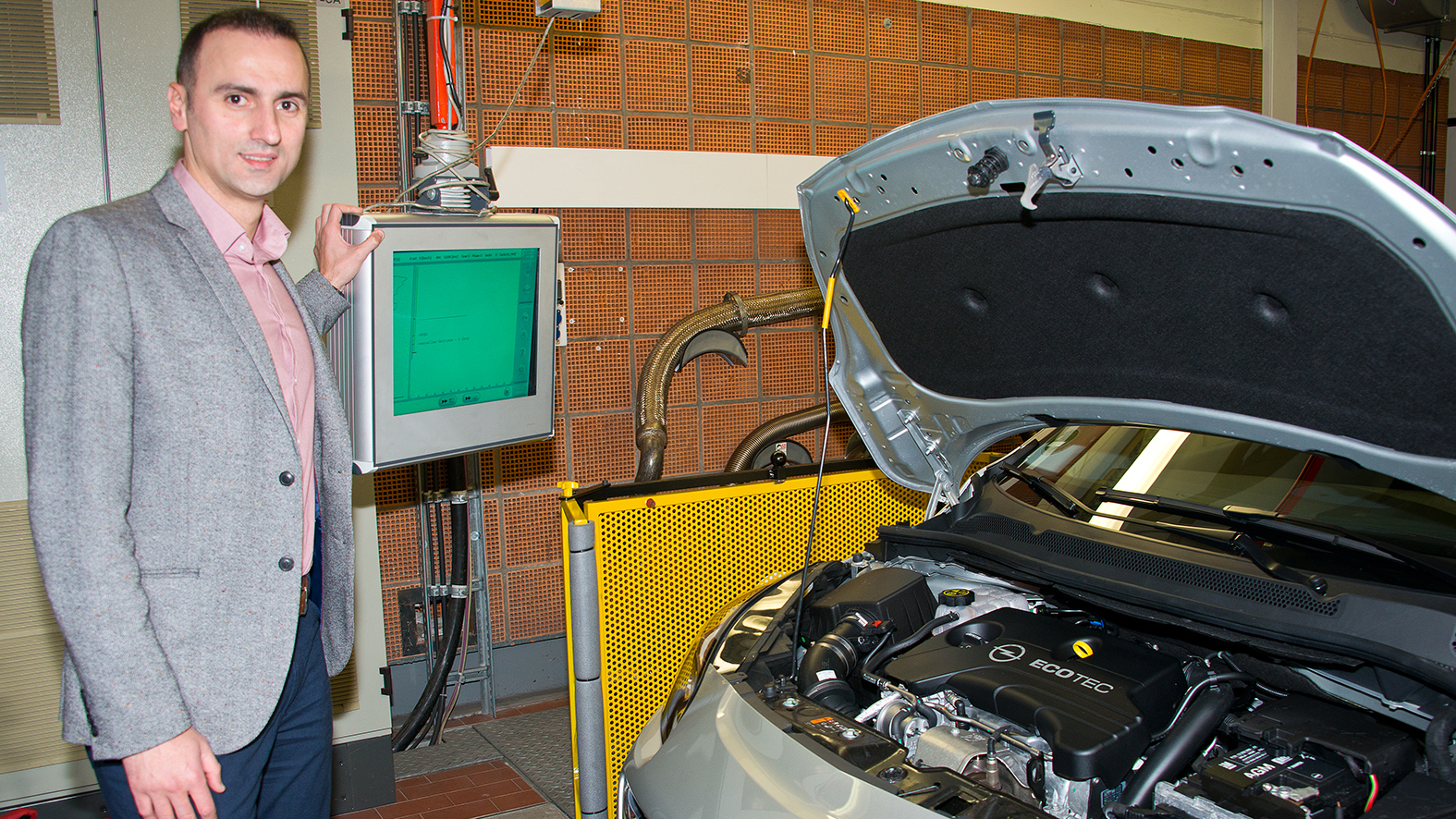 Vural Yanik, aged 37, oversees a Conformity of Production (COP) test, where an engine's consumption and emissions are checked