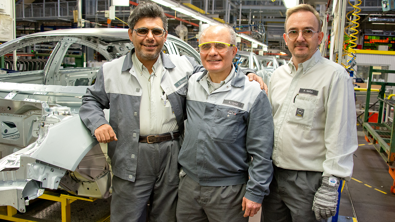 Ali Uysal (center), 54, at the production line with his colleagues Zeki Özdemir (left) and Manfred Hantel (right).