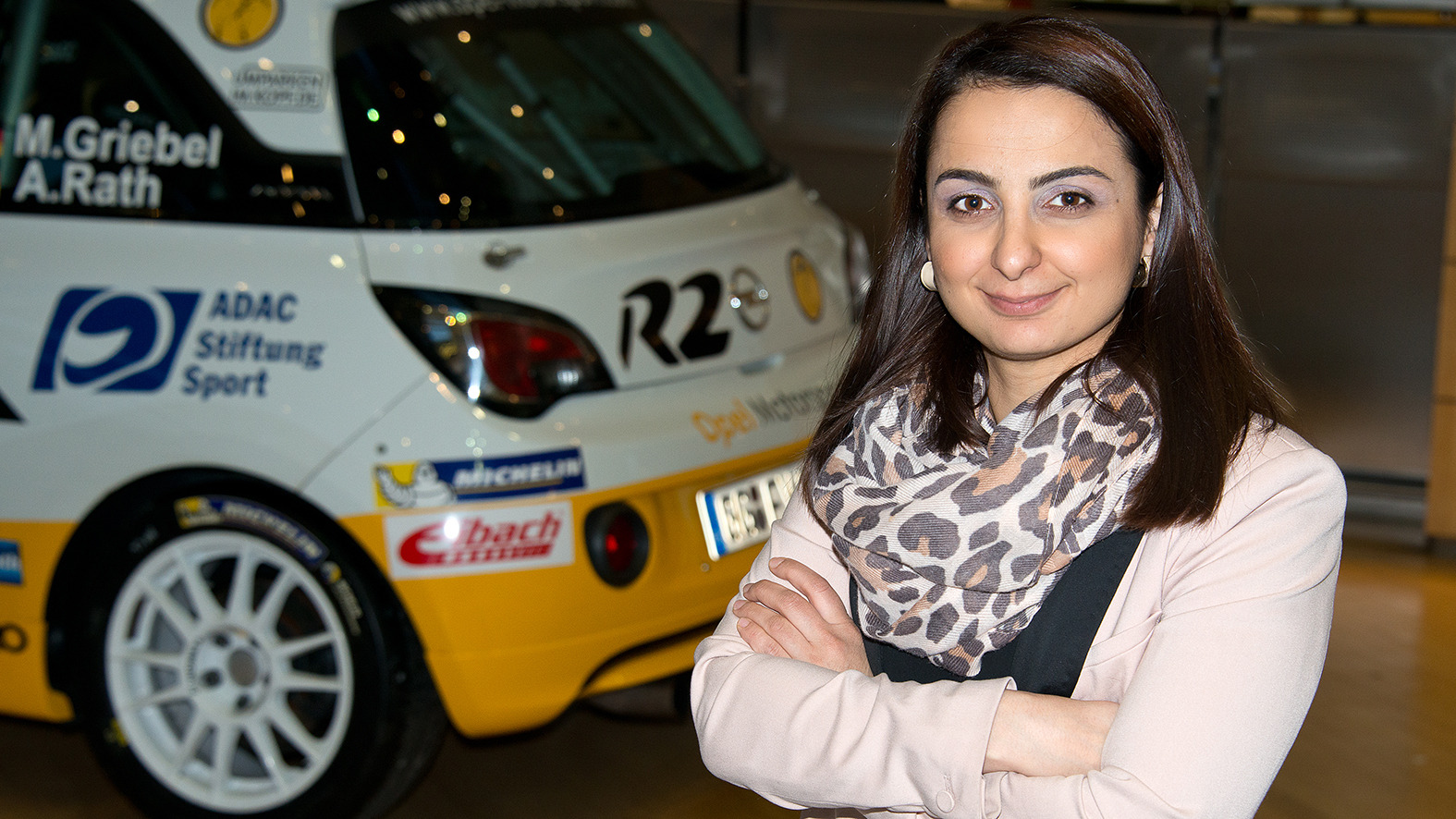 Aysel Kirazli, aged 32, in front of her favorite Opel, the R2, in the Adam Opel Building