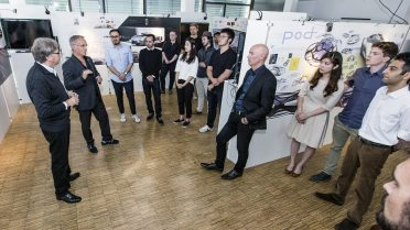 Creative characters: The students from Pforzheim University meet the Opel designers, Friedhelm Engler and Andrew Dyson (the men in suits, from left).